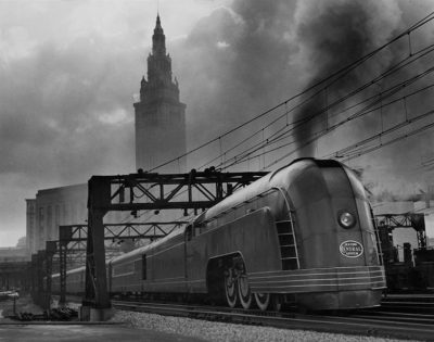 A New York Central Mercury train is dwarfed by Cleveland's Union Station, November 1936